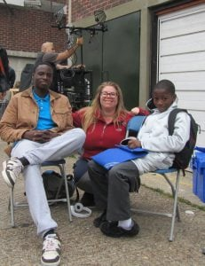 L-R: Juwon Adedokun, Sue Horth and Lambeth schoolboy Sammy Kamara
